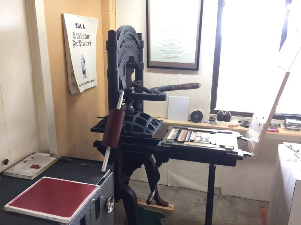 "This is ""Ben,"" the 100+ year old iron handpress, and my workstation."
