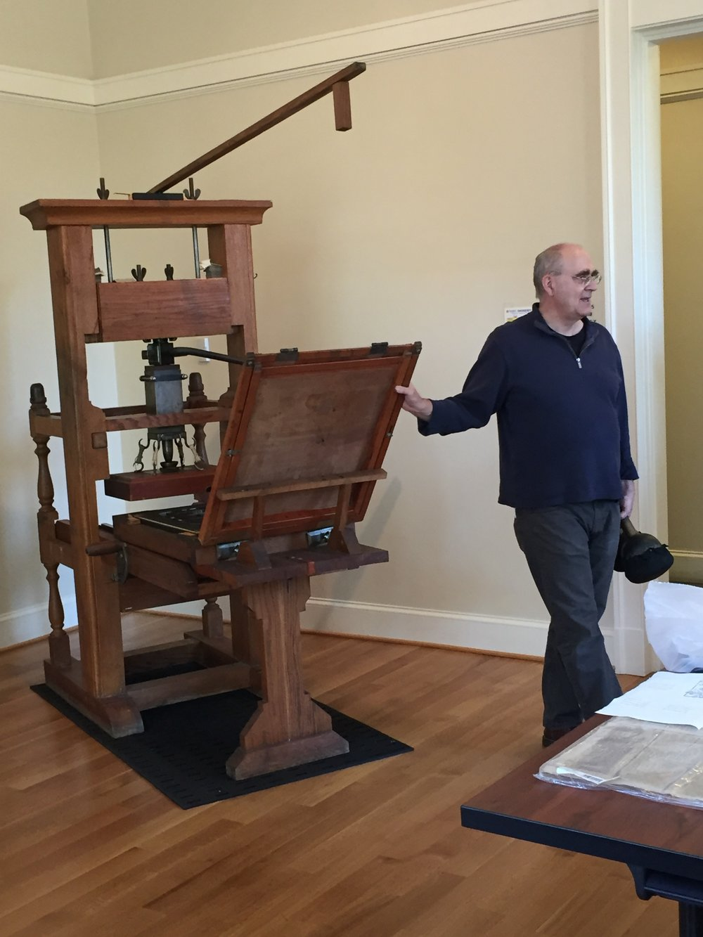 Josef Beery demonstrating UVA's wooden common press.