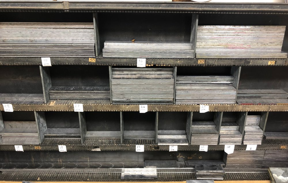 "A rack of metal strips, or ""slugs,"" in various lengths, to place between lines of type."