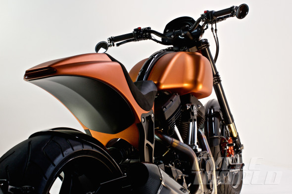 Yes, you read that correctly: The two-piece gas tank and the solo tail are machined from aluminum billet, anodized whatever color the buyer wants. Strangely there is no brand name nor model designation anywhere on the bike except the dash, in the interest of subtlety.