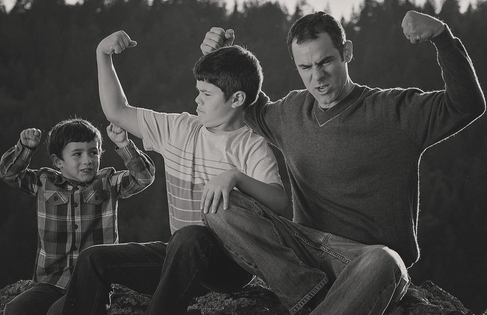Boys-Silly-Family-Dad-Father-Love-Strong-Flexing-Muscles-Black-And-White-Portrait