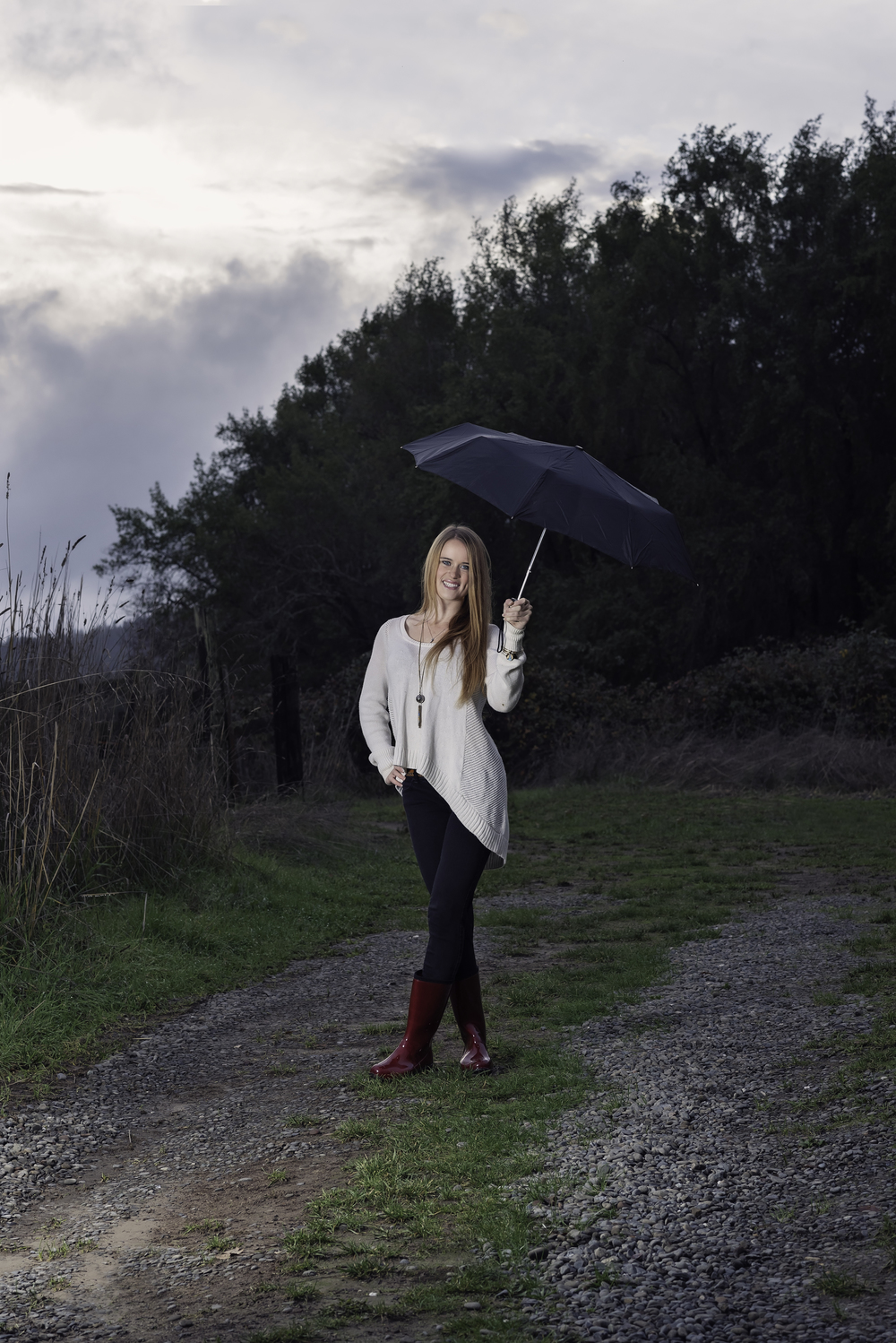 Senior-Portrait-Umbrella-Rain-Red-Rain-Boots-Smiles-Happy-Garberville-California-Southern-Humboldt-Community-Park-Country-Girl-Gravel-Path-Dirt-Road