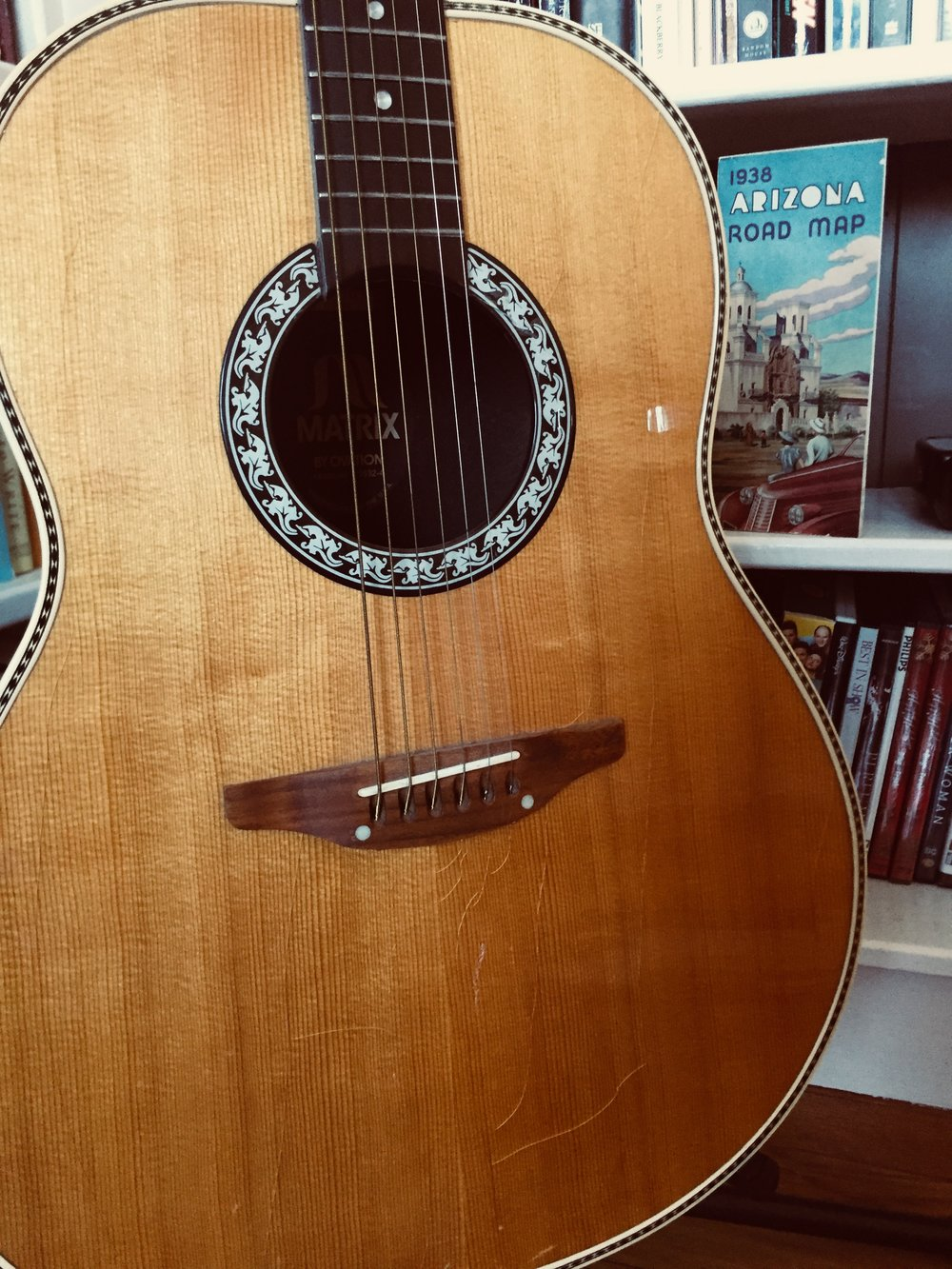 My dad's Ovation hollow body, with a few cracks in the body. Along with a 1938 map of Arizona that my grandfather used when he spent time out west being a cowboy.