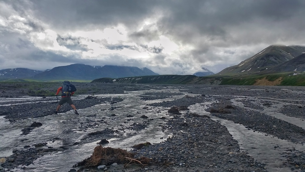 Chris making his way across one of the braided rivers in Unit 13.