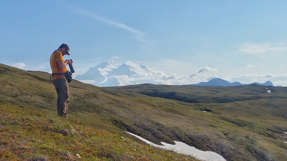 Chris photographing the clear view of Mount Denali.