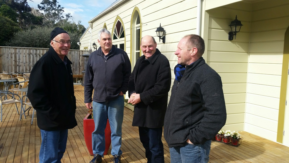 The three agri guides Dave Hopkins, Joe Carey and Peter Henderson with Kelvin Day, ( 2nd from left) at Tairoa Church, part of Tairoa Lodge, the elegant accommodation on the 2nd night of the Agri tour.