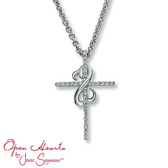 Open Hearts Cross Necklace 1/6 ct tw Diamonds Sterling Silver A diamond-decorated cross dazzles in this elegant necklace for her. Diamond Total Carat Weight may range from .145 - .17 carats.