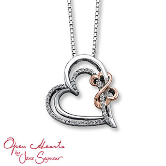 Open Hearts by Jane Seymour® Diamond Necklace    Round diamonds and styled in sterling silver. The Open Hearts Design, in 14K pink gold, completes the look. 1/8 carat total weight.
