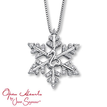 Open Hearts by Jane Seymour® Diamond Snowflake Necklace    Sterling silver snowflake is frosted in diamonds for shimmering sparkle. The iconic Open Hearts Design adds warmth. 1/10 carat total weight.