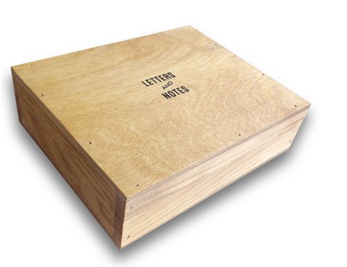 A classic wooden box, that will look good on your desk AND hide away your mess.                                                                                                                                                       Via threepotatofour.com