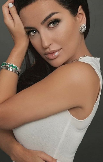 - Gina Amir wearing custom Emerald and Diamond Bracelet