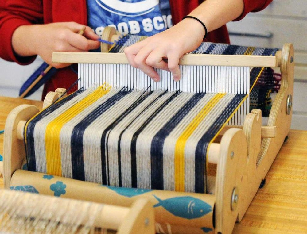 Ruben Marroquin teaches weaving to fourth-grade students at the Cos Cob School in Greenwich, Conn., Friday, Oct. 5, 2018. Marroquin, a weaver who studied at F.I.T., has roots in both Guatemala and Venezuela, visited the school as part of an interdisciplinary weaving and Spanish workshop that was part of National Hispanic Heritage Month.