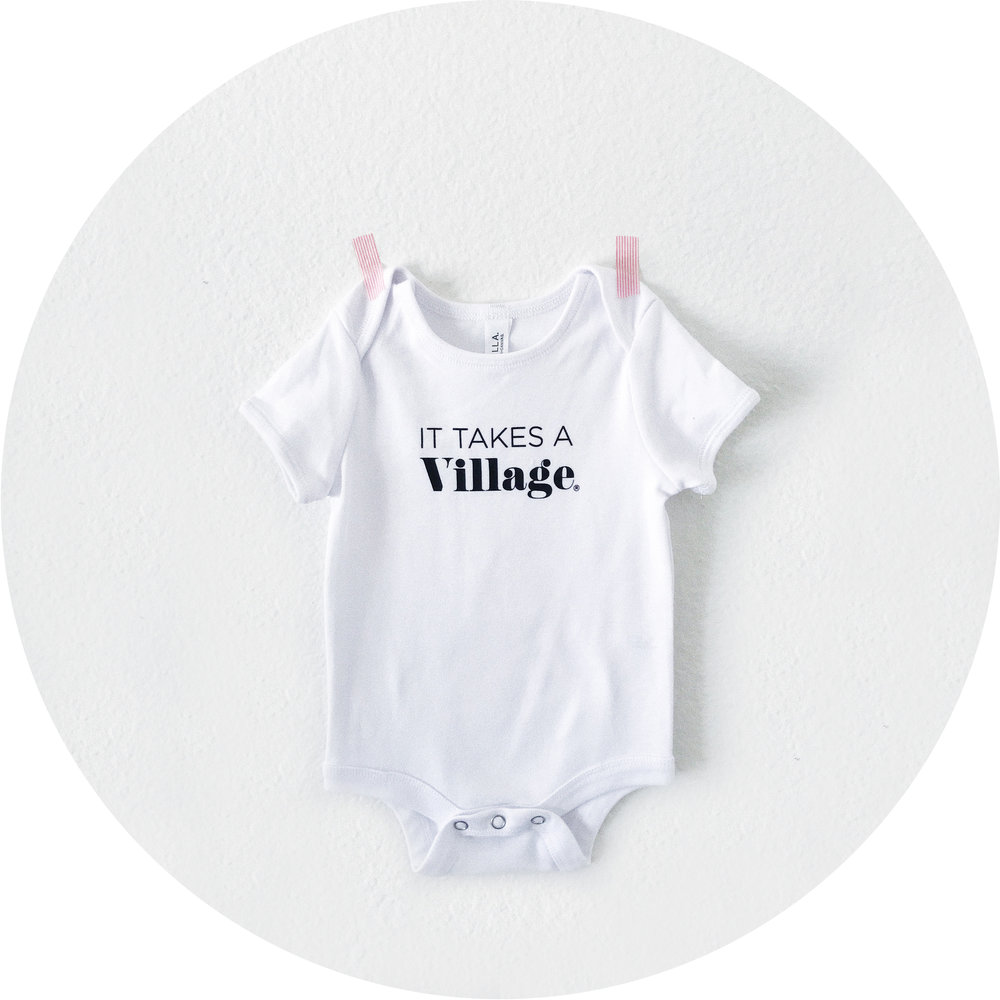 It_Takes_a_Village_Onesie_shop.jpg