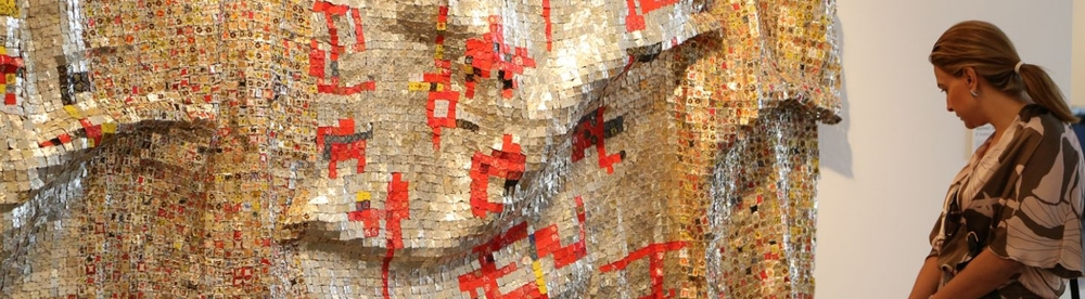 El Anatsui has gained widespread international acclaim in recent years for his dazzling metallic tapestries made from liquor bottle tops.