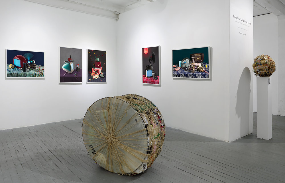"""Tech Vanitas"" photos by Jeanette May and sculpture by Mary Mattingly. Exhibition photo courtesy of The Cluster Gallery."
