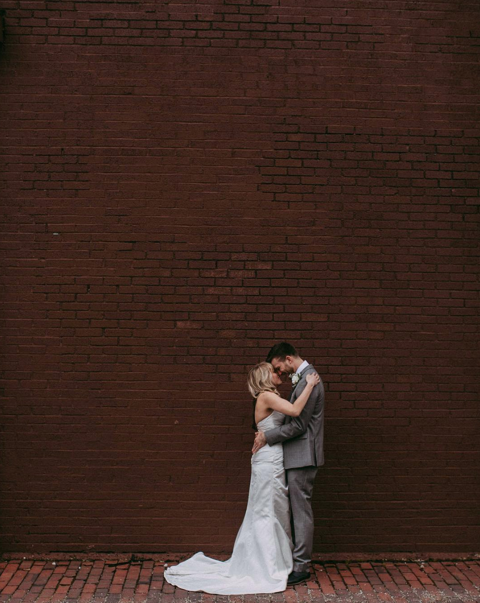 """- """"My husband and I wanted a photographer that we felt comfortable with, and who would capture the essence of our happiness on the wedding day, and we truly found that with Caroline! She was happy to accompany us to our venue walk through so that she could get fully prepared for the wedding day. Caroline had creative ideas about taking pictures, and made sure to listen fully to what we wanted and to fill in the gaps because we aren't photographers ourselves! On the wedding day, she and her second shooter were present, but not distracting to the ceremony or reception, and we were so thankful that they had the foresight to capture moments that were a blur to us because the day was so busy! We are so happy and satisfied with our pictures, and we got them back so quickly! Caroline is passionate about her work, and is dedicated to creating the best possible experience and product to her customers. So happy with our treasured pictures that capture the memory of the most special day of our lives!""""-Jenn & Jeff M."""