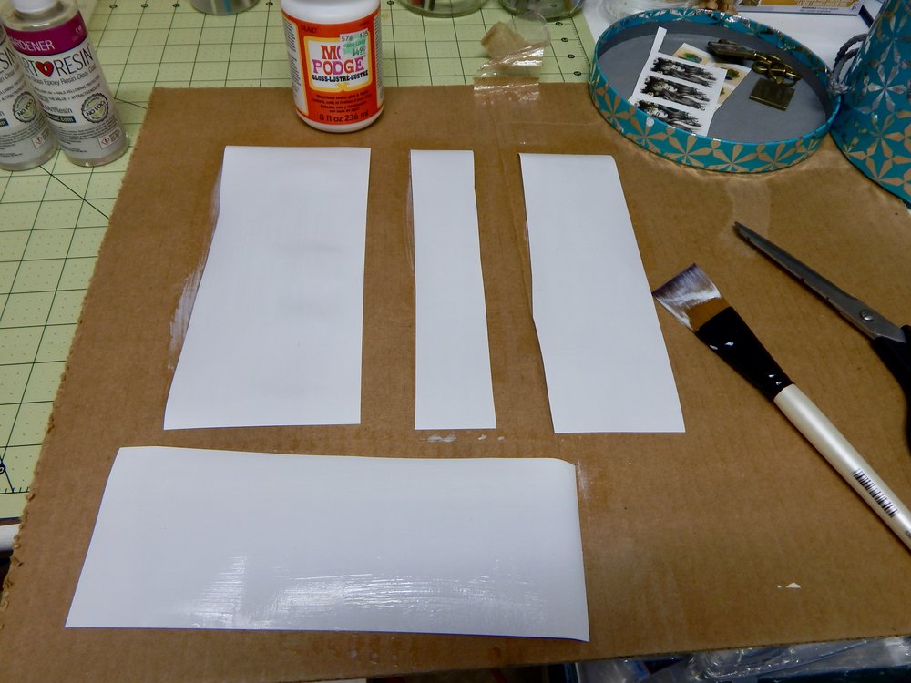 It may be easier to coat the back after you've cut the paper in to manageable strips. Do whatever works best for you!