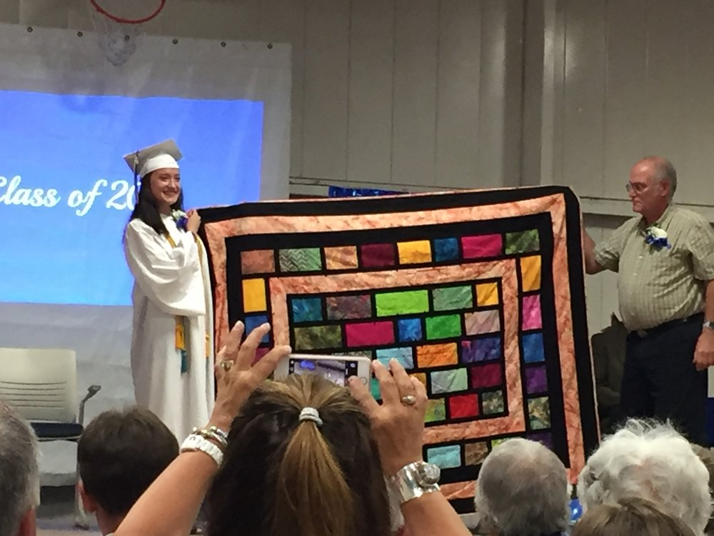 """Elena and her quilt  Linda Henkel designed this quilt for Elena with a bit of """"edginess"""" to fit Elena's personality and style."""