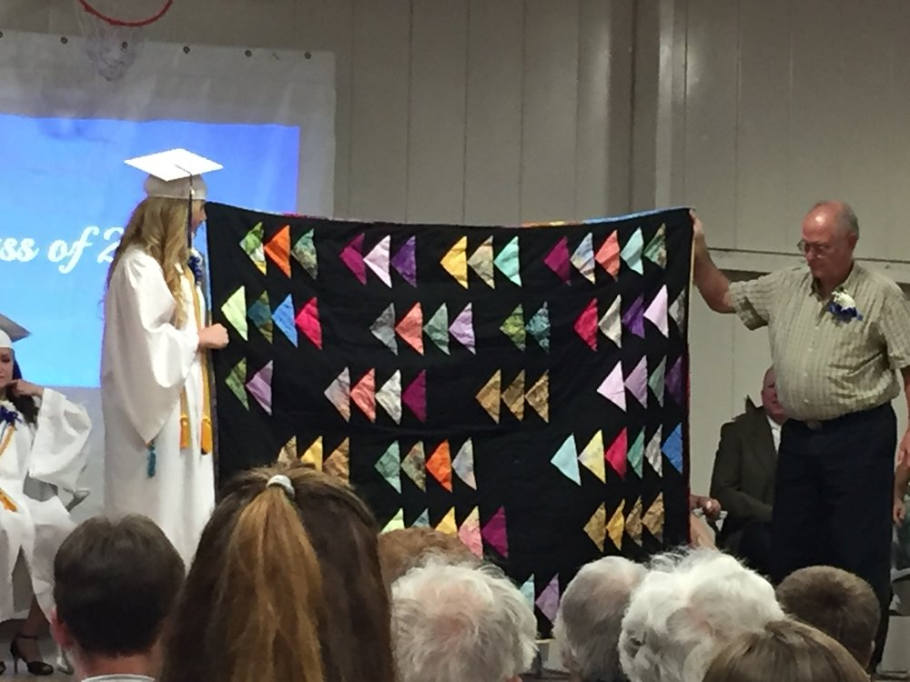 """Hailey Jorgenson with her """"Flying Geese"""" quilt."""