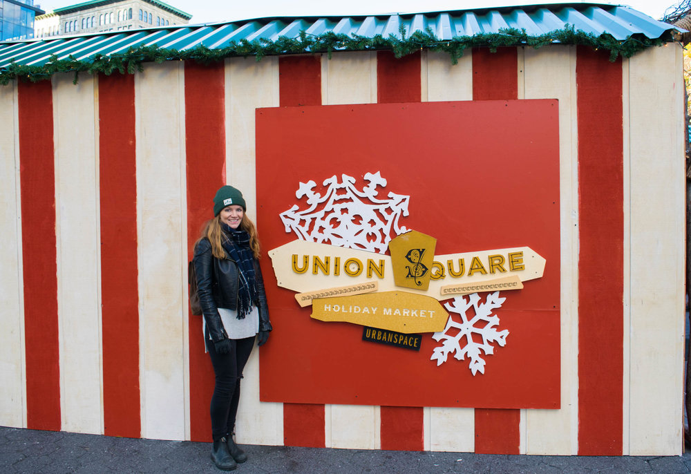 Girl stood next to Union Square Christmas Market.