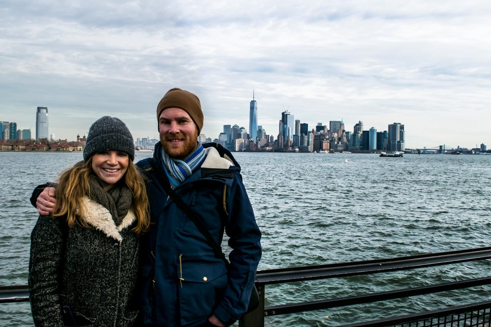 Couple in front of Manhattan skyline.