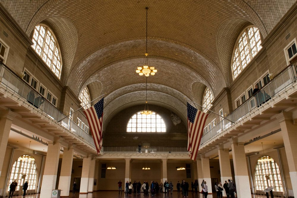 Main building on Ellis Island with American flags.