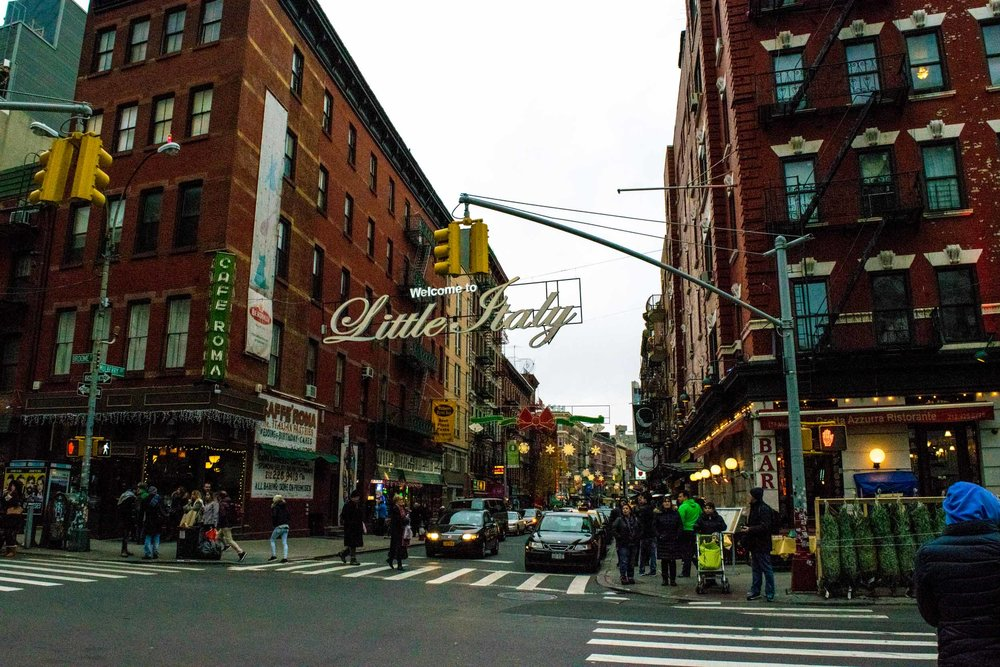 Little Italy, New York City with traffic and pedestrians.