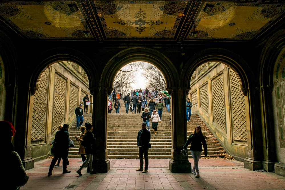 Man stood in the Bethesda Terrace Arcade in Central Park.