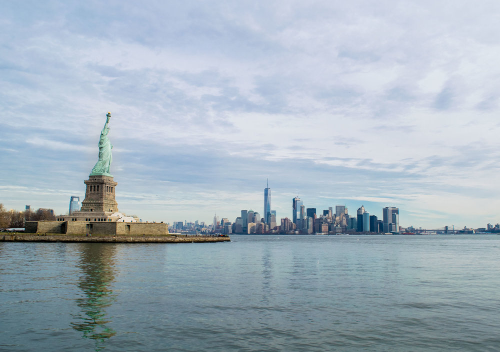View of the Statue of Liberty with Manhattan skyline behind.
