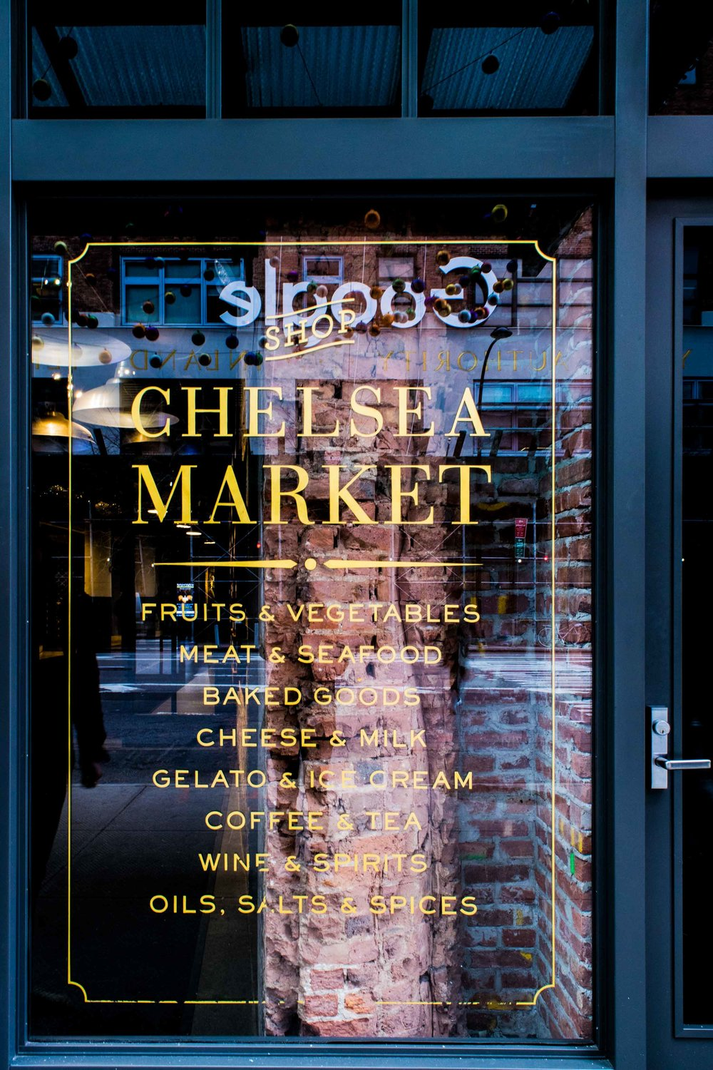 Chelsea Market window listing goods which can be found inside.