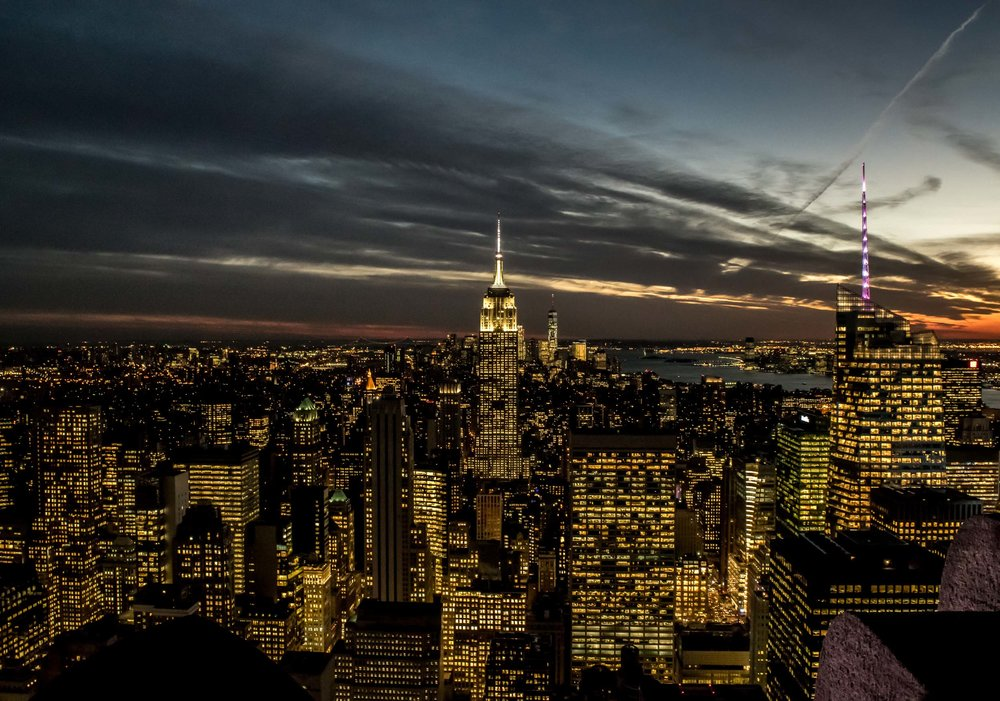 Night time view of the Empire State Building and New York City skyline, taken from the Top of the Rock.