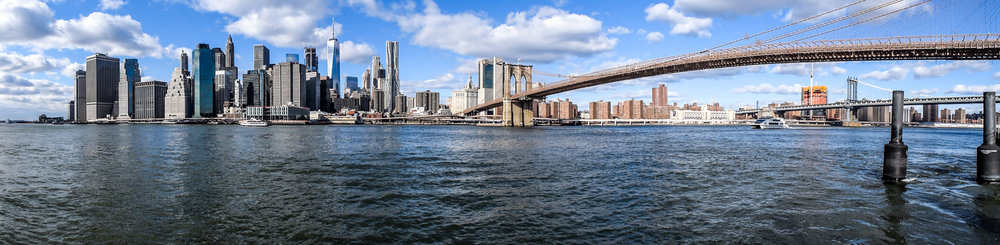Panorama of the Brooklyn Bridge and Manhattan skyline featuring World Trade One.