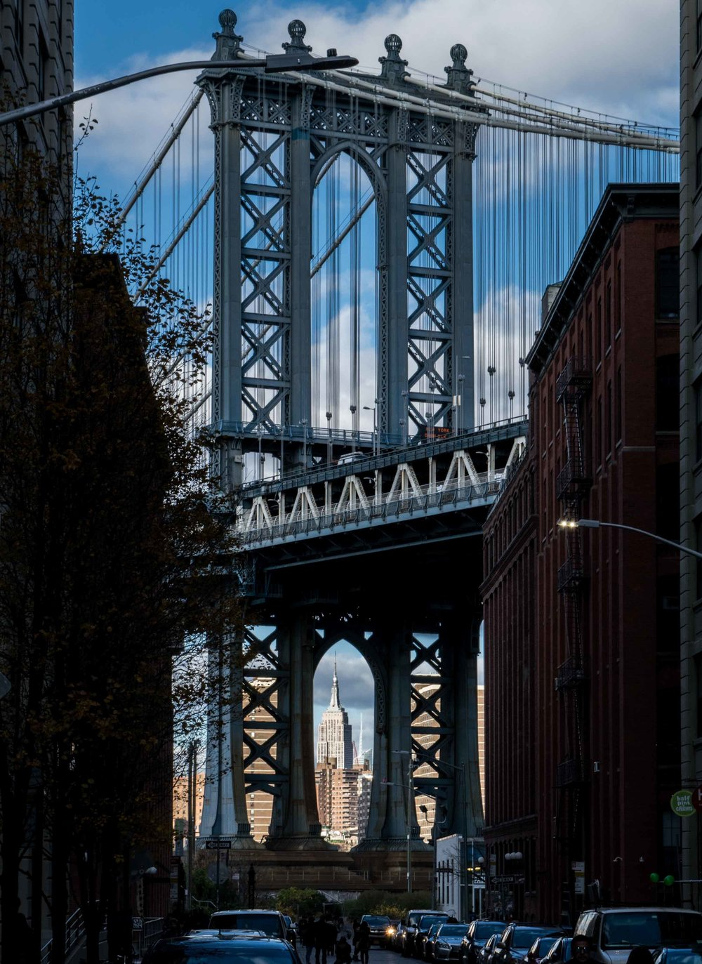 View of the Empire State Building between the Manhattan Bridge arches, taken in Dumbo.