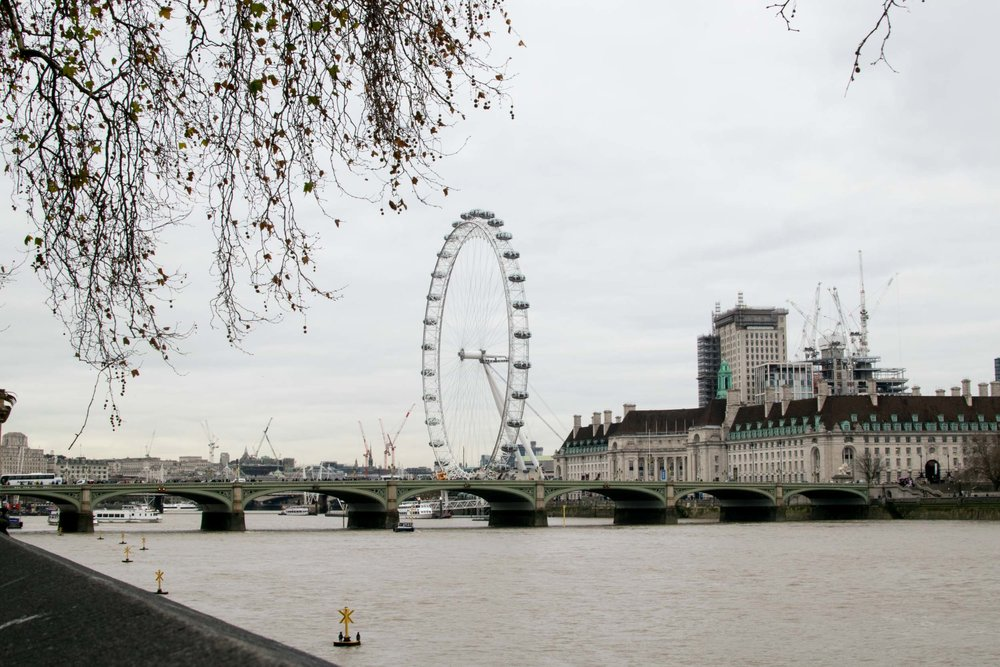 The River Thames with Westminster Bridge and the Coca-cola London Eye.