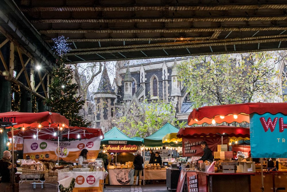 Borough Market food stalls with Southwark Cathedral behind.