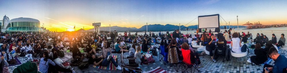 Sunset at Canada Place's North Point where a crowd gathers to watch a waterfront movie in Vancouver.