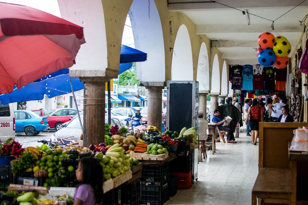 Shopping at the market on a rainy day in Valladolid, Mexico.