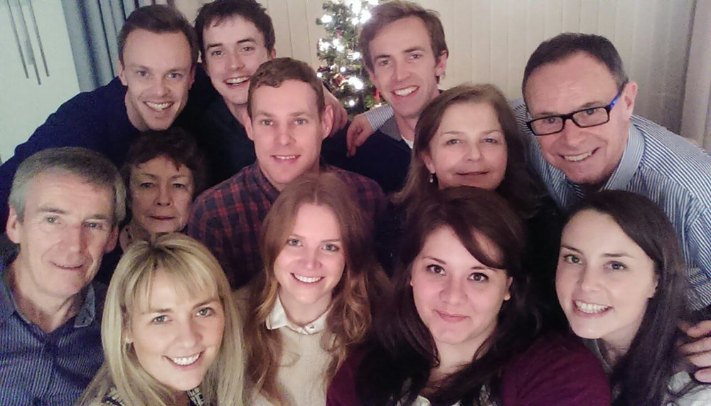 Family selfie at Christmas time, reunited after a few years apart.