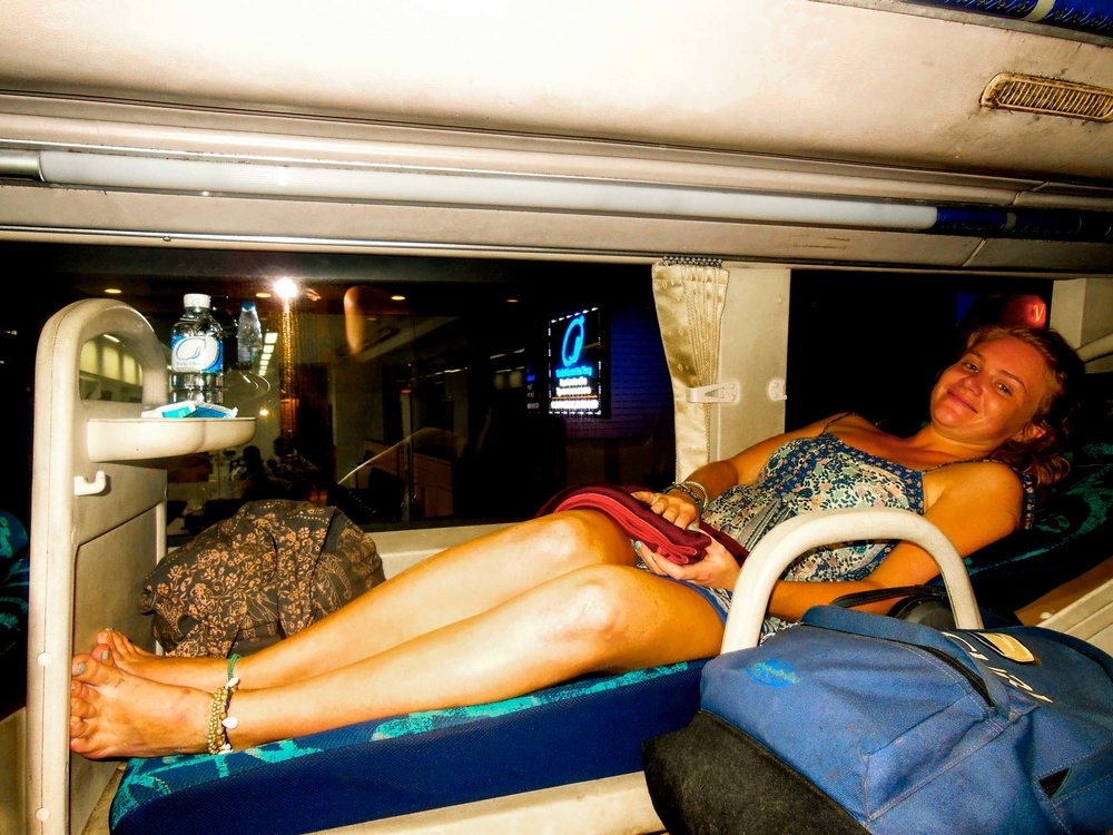 Woman on sleeper bus while backpacking in South East Asia.