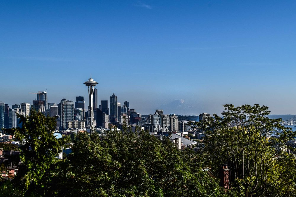 View of Seattle skyline with Space Needle and Mount Rainier faintly in the distance. Taken from Kerry Park, Seattle, Washington, USA.