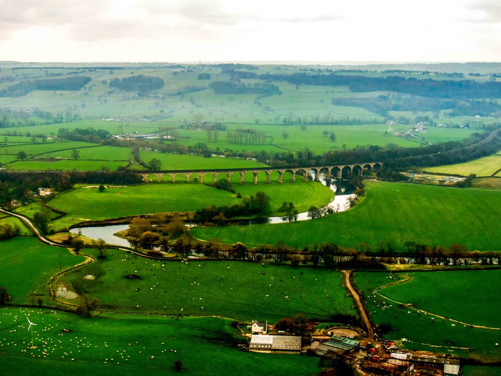 View over the Yorkshire Dales and viaduct, taken from a helicopter.