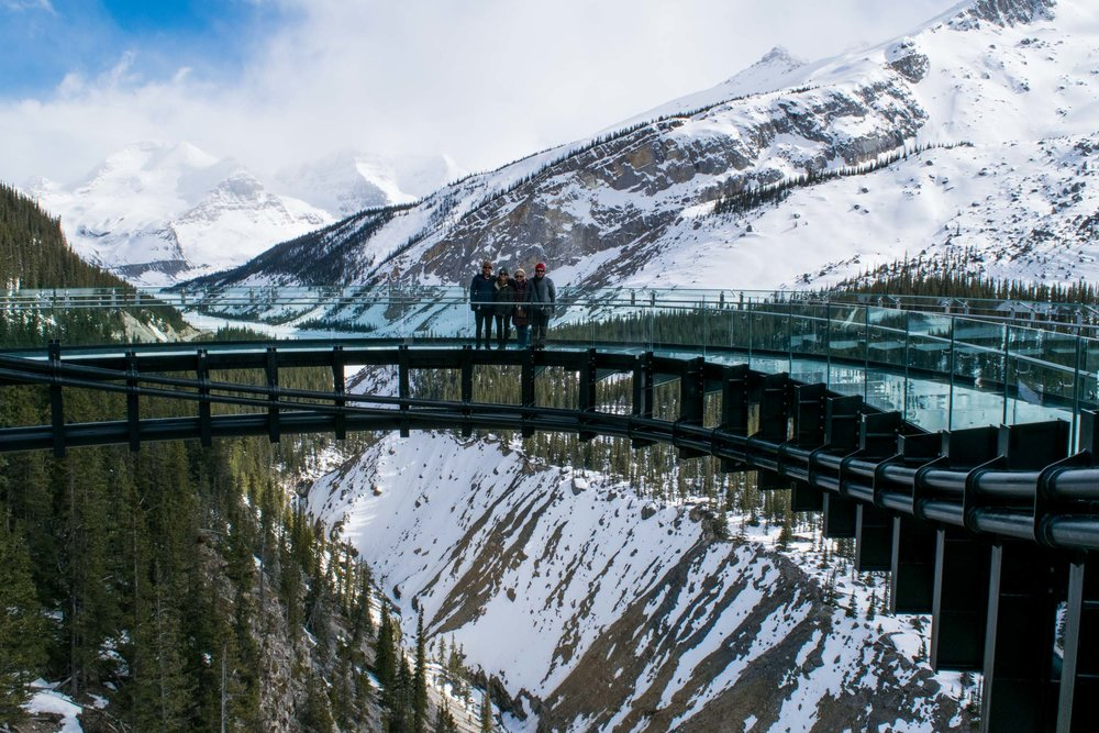 Family stood on the Glacier Skywalk at the Columbia Icefields in Alerbta, Canada.
