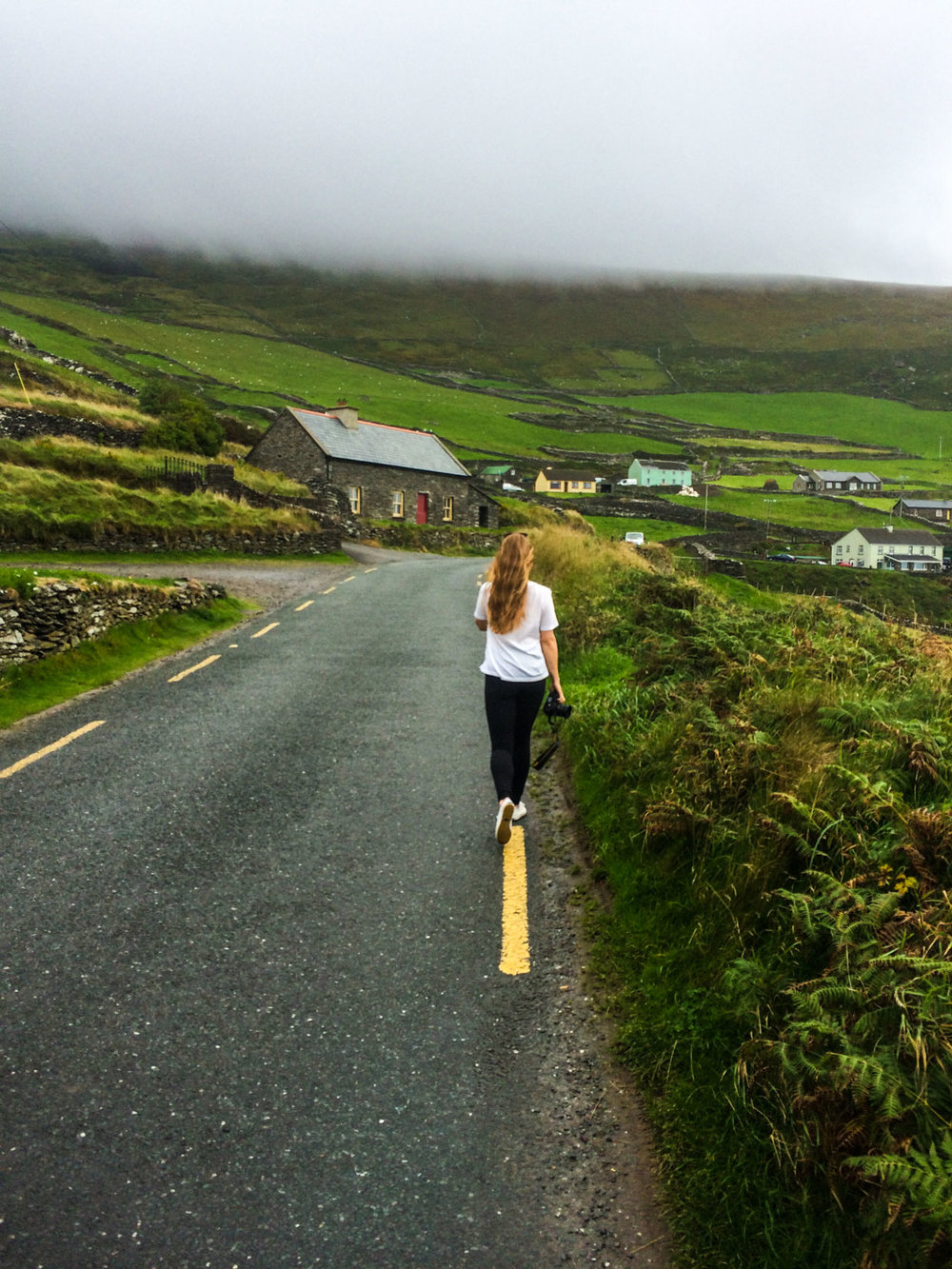 Female photographer exploring from Killarney to Dingle, County Kerry, Ireland.