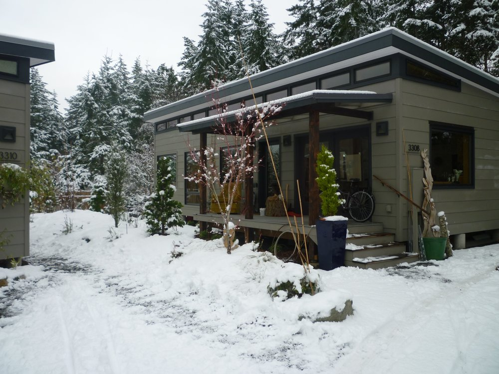 My new workshop/home (right),  with rental house on the left. Snow on Christmas Day.