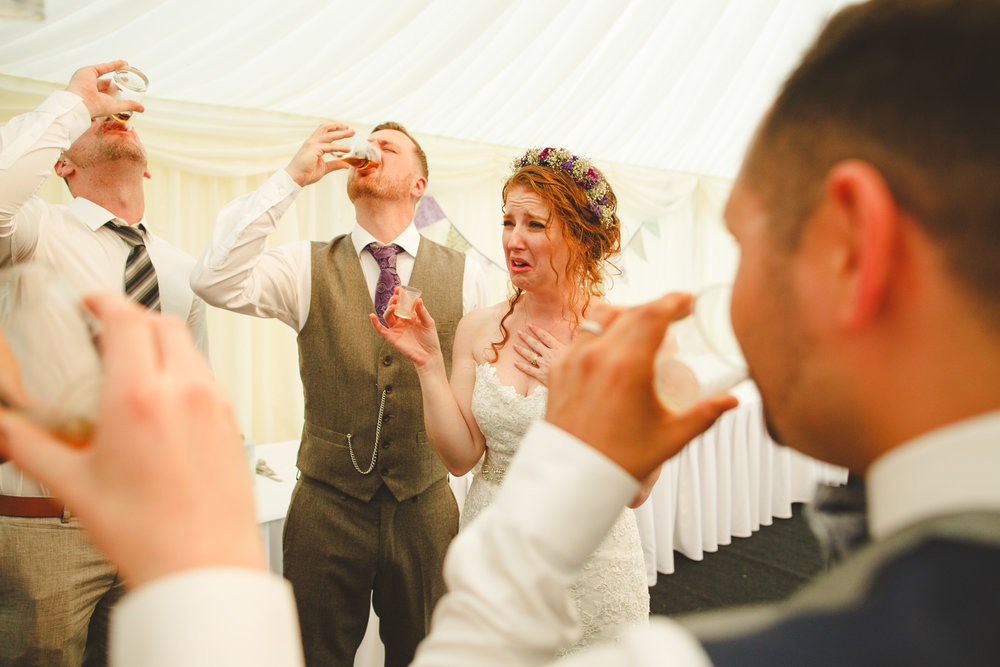 bride drinking shots, reportage wedding photo