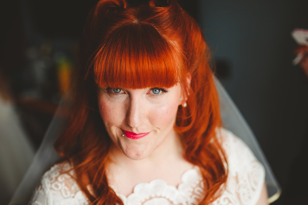 red haired vintage style bride wedding photo