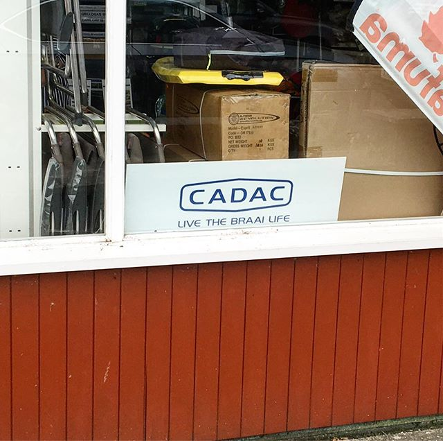 """@Cadac live the Braai life"" Visiting the jurassic coast and this sign is in the window of the first shop we get to! 😲😲😲😁😁😁..... #cadac #braai #jurassiccoast #bbq #uk @braaiboy"