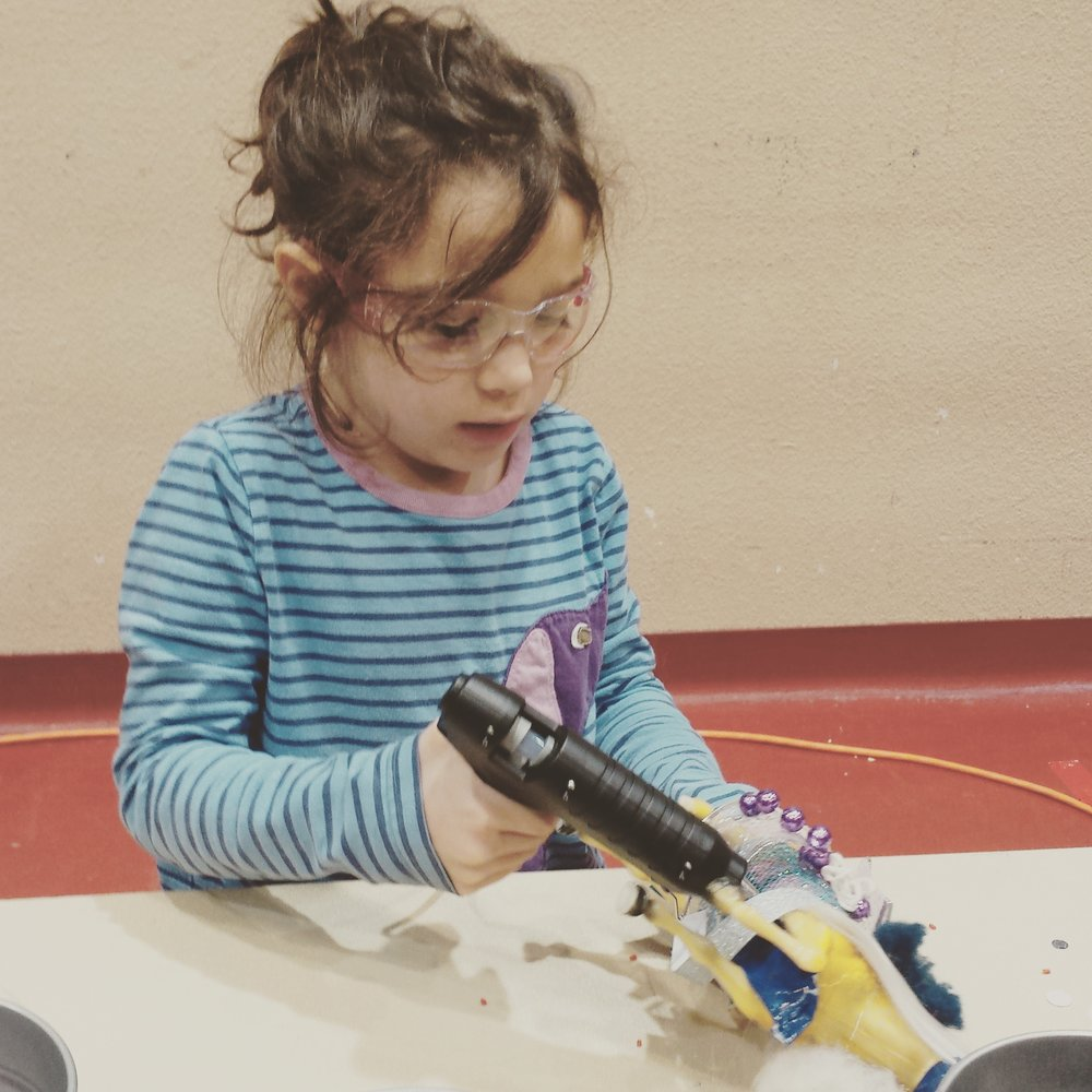 Our glue-gun wielding daughter, Norah, showing how Frankentoys are made at Madison's First Annual Maker Faire