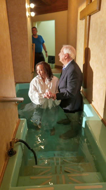 Baptized by Pastor Sam with Daddy watching