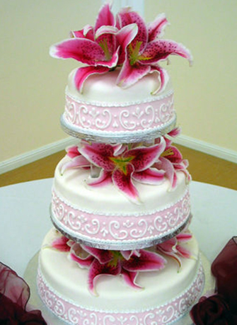 3. Wedding cake with pink tiger lilies